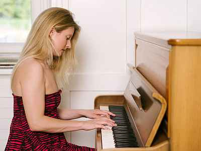 Woman playing piano to relax